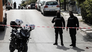 Police block the road after journalist Giorgos Karaivaz was killed outside his house in Athens