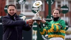 Henry de Bromhead and Rachael Blackmore pose with the trophy after Minella Times' heroics in the world's most famous steeplechase