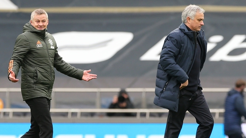 Ole Gunnar Solskjaer and Jose Mourinho leave the pitch after the game with rather different expressions