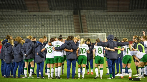 Irish players huddle together after the game in Brussels