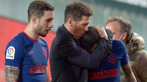 Atletico Madrid boss Diego Simeone comforts his compatriot Angel Correa after their draw against Real Betis