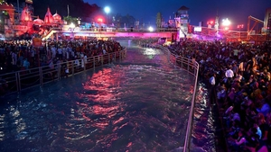 Despite the pandemic, Hindu devotees gather on the banks of the Ganges River during a religious festival in India