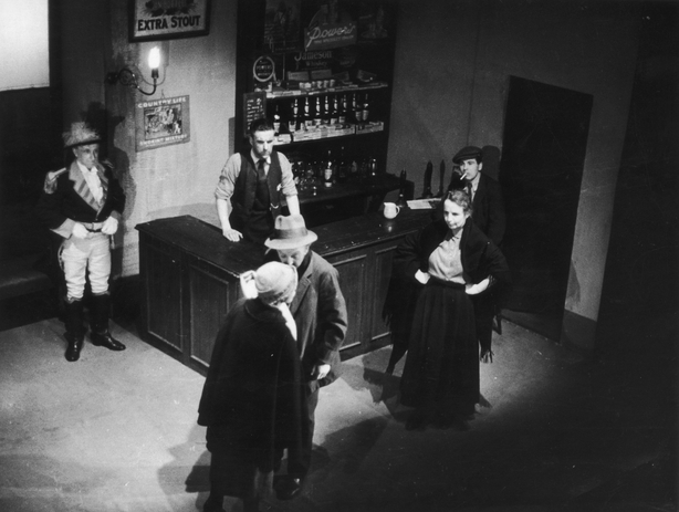 01 Jan 1942 The Plough And The Stars Prostitute Rosie Redmond meets Fluther Good, played by F.J. McCormick, in a scene from an Abbey Theatre production of Sean O'Casey's 'The Plough And The Stars', 1942. (Photo by Haywood Magee/Picture Post/Hulton Archive/Getty Images) Dublin - Republic of Ireland,Actor,1940-1949,Actress,Business Finance and Industry,Full Length,Archival,Prostitution,Arts Culture and Entertainment,Food and Drink Establishment,Black And White,Theatrical Performance,Sean O'Casey,Prostitute,Industry