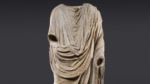 The marble piece is a full-body, headless 1st century statue of a toga-wearing man