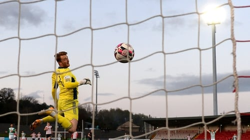 Derry City goalkeeper Nathan Gartside could do nothing to keep out Burke's effort from the halfway line