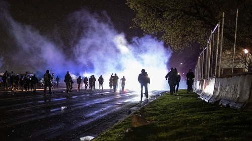 Protesters clash with police in front of the police station in Brooklyn Center, Minneapolis