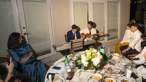 Judy Kaiser (left) and her son Menachem Kaiser (holding the guitar) pictured together at his brother's wedding