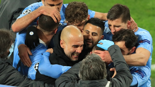 Pep Guardiola celebrates with his players after Phil Foden's decisive goal