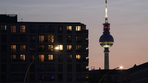 The broadcast tower at Alexanderplatz behind a new residential apartment building in Berlin