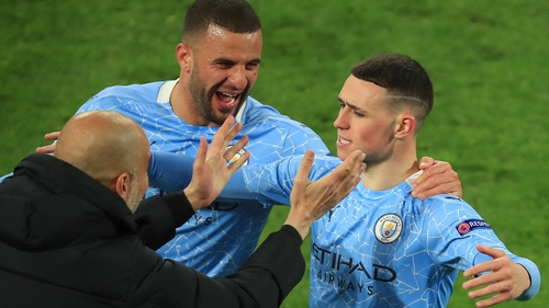 Phil Foden celebrates scoring City's second goal on the night with manager Pep Guardiola and team-mate Kyle Walker