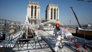 A worker walks on the roof of the Notre-Dame de Paris Cathedral this morning