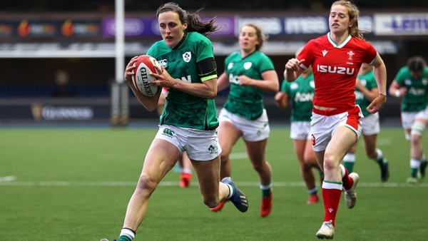 Hannah Tyrrell runs in a try against Wales