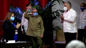 Raul Castro is applauded after announcing his decision, watched on by Cuban President Miguel Diaz-Canel (R)