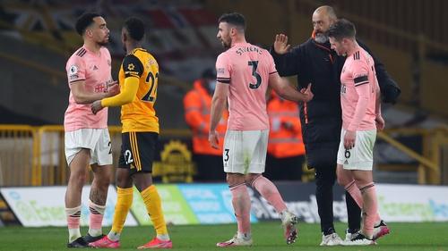 Wolves manager Nuno Espirito Santo consoles Enda Stevens at the final whistle