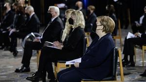 German President Frank-Walter Steinmeier (L) and German Chancellor Angela Merkel (R) at the morning service
