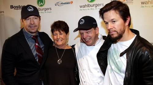 (L-R) Donnie Wahlberg, his mother Alma and brothers Paul and Mark at the opening of the family's Wahlburgers restaurant at the Hingham Shipyard in Boston, Massachusetts in October 2011
