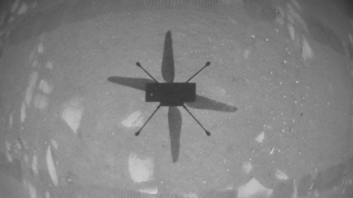 A handout image from NASA shows the shadow of the Ingenuity helicopter during its first test flight on Mars