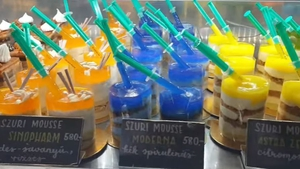 Colourful mousses with syringes celebrating Covid vaccines at the Sulyan patisserie in Hungary