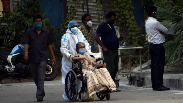 A patient with Covid-19 is brought to a hospital in Kolkata, India