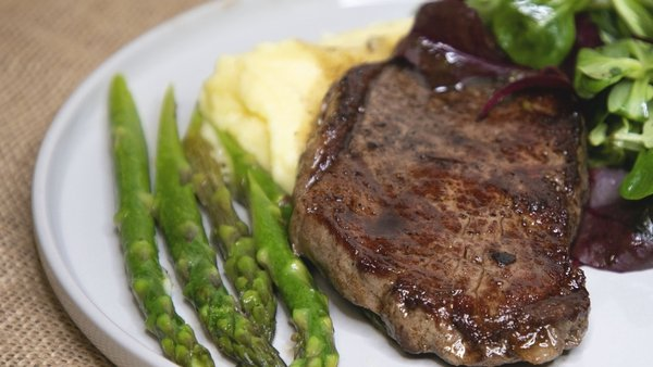 Kevin Dundon's perfect beef striploin with confit garlic butter and asparagus.