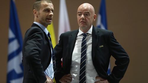 UEFA President Aleksander Ceferin (L) and FIFA President Gianni Infantino pictured in 2017