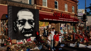 People gather at a makeshift memorial to George Floyd near the site where he died in police custody in Minneapolis