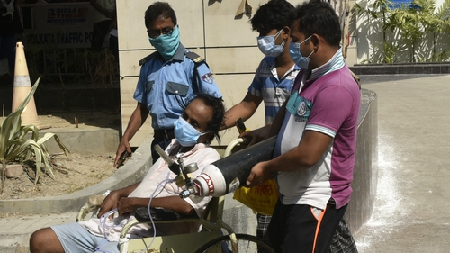 A patient with Covid-19 is brought to hospital in Kolkata