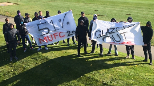 Manchester United fans at the club's training ground (picture courtesy of @RedIssue)