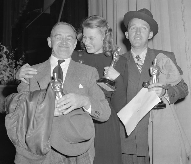 "The Winners. Hollywood, Calif.: Barry Fitzgerald (left), Ingrid Bergman and Bing Crosby (right) hold ""Oscars"" awarded them for outstanding performances in 1944. Fitzgerald was named best supporting actor for his role in Going My Way, in which picture Crosby&squot;s leading role won him best male actor award. Miss Bergman, best female actress, won top honors for her acting in Gaslight. Awards were made at Annual Motion Picture Academy presentations."