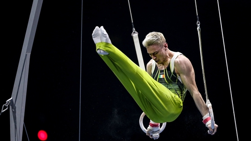 Adam Steele of Ireland competes on the rings