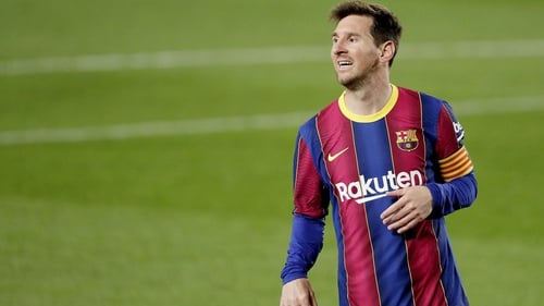Lionel Messi scored twice as Barcelona remain in the hunt for the league title