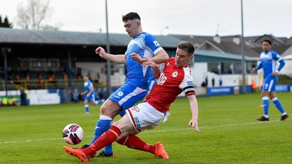 Ian Bermingham of St Pat's in action against Karl O'Sullivan