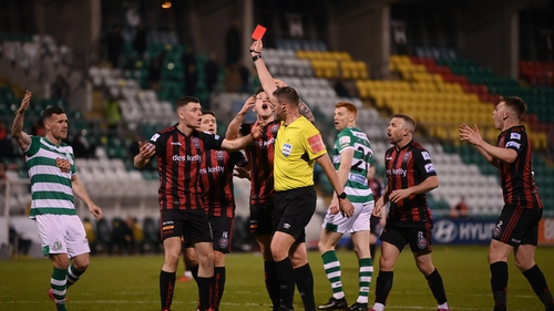 James Finnerty receives a red card from referee Paul McLaughlin