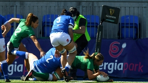 Dorothy Wall barges over for Ireland's opening try of the game