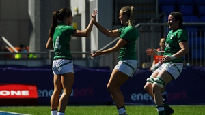 Amee Leigh Murphy-Crowe celebrates her first try with team-mates Stacey Flood and Hannah O'Connor