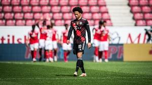 Leroy Sane looks on as Mainz players celebrate their first goal