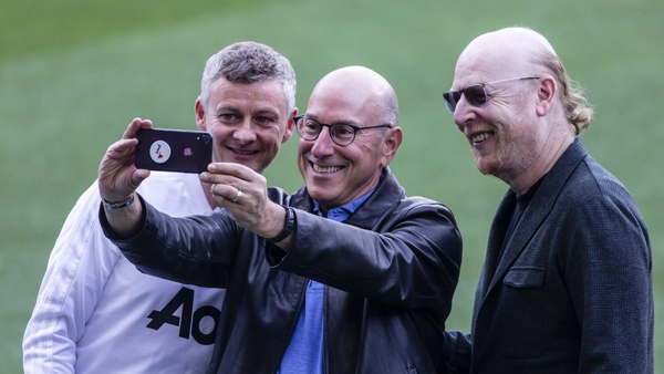 Ole Gunnar Solksjaer with a couple of the Glazer clan