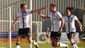 David McMillan celebrates with Patrick McEleney and Han Jeongwoo after scoring his side's first goal