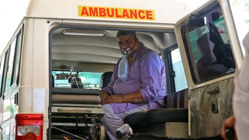 A Covid-19 patient in Jaipur, Rajasthan, receives oxygen in an ambulance outside busy hospital