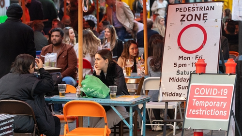 People eating and drinking outside today in London, England