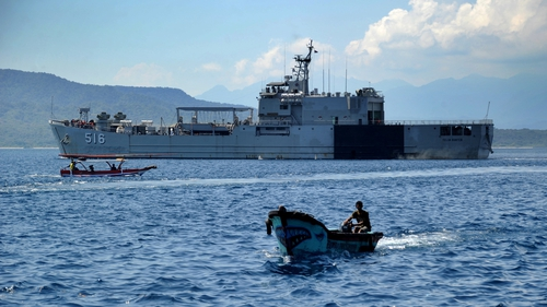 An Indonesia Navy ship sets off from the Tanjungwangi port near the naval base in Banyuwangi, East Java province