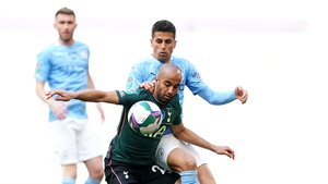 Lucas Moura battles for possession with Joao Cancelo