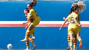 Jennifer Hermoso (L) celebrates with team-mates after scoring against PSG