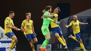 Zander Clark is congratulated after the levelling goal at Ibrox