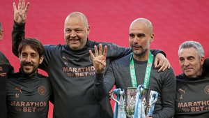 Pep Guardiola (second right) and his coaches pose with the Carabao Cup trophy