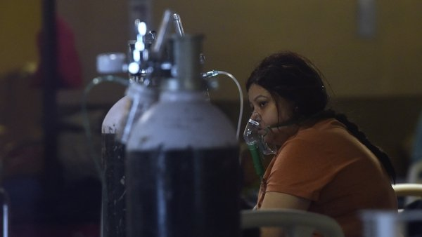 A patient on oxygen at a temporary Covid-19 care centre in New Delhi