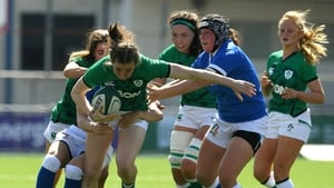 Eve Higgins is tackled by Veronica Madia and Erika Skofca
