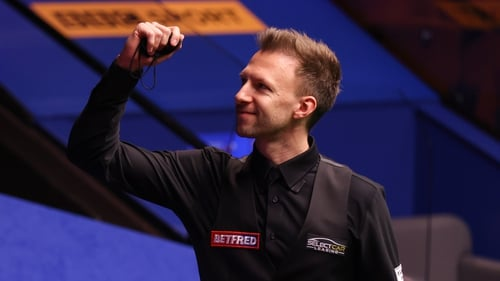 Judd Trump eased into the quarter finals in Sheffield