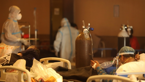Patients are tended to in a makeshift Covid-19 ward in New Delhi