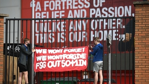 Supporters protest against Liverpool's US owner John Henry and FSG outside Anfield
